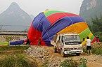 20090502 Collapsing a balloon Yangshuo 5928.jpg