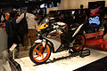 2011 orange and gray Honda CBR125R at EICMA.jpg