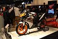 2011 orange and gray Honda CBR125R at EICMA.jpg