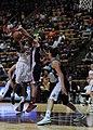 2013 Virginia Tech - Robert Morris - Nia Evans shooting with defense.jpg