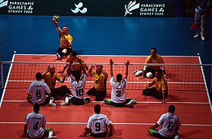 Libya at the 2000 Summer Paralympics - Australian sitting volleyball team serves the ball to Libya during 2000 Sydney Paralympic Games match, seen from above.
