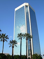 low angle shot of modern all–glass office building in downtown Phoenix.