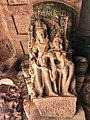 6th century amorous couple on pillar top looking below in Cave 3, Badami Hindu cave temple Karnataka 4.jpg