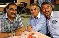 98z7q Drei Freunde auf der Abschlussveranstaltung zur Mahnwache auf dem Klagesmarkt in Hannover 2013 für Pressefreiheit und Demokratie in der Türkei.jpg