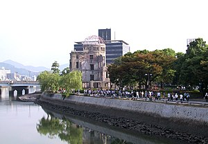 Hibakusha - Citizens of Hiroshima walk by the Hiroshima Peace Memorial, the closest building to Ground Zero to have survived the city's atomic bombing.