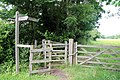 A Betts Lane kissing gate and finger post at Nazeing, Essex, England.JPG