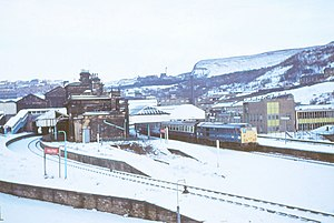 Halifax railway station (West Yorkshire) - A Brush Class 31 awaits departure with the 0835 train to London at Halifax in 1973.  The platforms to the left no longer remain and are occupied by Eureka!.