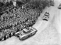 A Churchill Mk VII tank leads a group of Shermans as part of the Royal Tank Regiment's contingent during the London Victory Parade, 8 June 1946. H42780.jpg