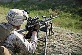 A U.S. Marine with Golf Company, 2nd Battalion, 2nd Marine Regiment, assigned to Black Sea Rotational Force (BSRF) 14-2A, adjusts the optics on an M249 light machine gun Aug. 27, 2014, at a range near Mihail 140827-M-KK554-013.jpg