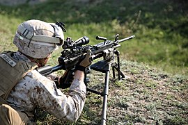 A U.S. Marine with Golf Company, 2nd Battalion, 2nd Marine Regiment, assigned to Black Sea Rotational Force (BSRF) 14-2A, adjusts the optics on an M249 light machine gun Aug. 27, 2014, at a range near Mihail 140827-M-KK554-013.jpg
