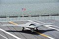 A U.S. Navy X-47B unmanned combat air system demonstrator aircraft taxis on the flight deck of the aircraft carrier USS George H.W. Bush (CVN 77) off the coast of Norfolk, Va., May 10, 2013 130510-N-FU443-604.jpg