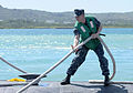 A U.S. Sailor secures mooring lines aboard the attack submarine USS Jacksonville (SSN 699) as the submarine arrives for maintenance in Apra Harbor, Guam, April 9, 2013 130409-N-LS794-159.jpg