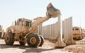A U.S. Soldier with the 124th Engineer Company, South Carolina Army National Guard uses a front-end loader to move blast-resistant concrete barriers Oct. 10, 2013, at Multinational Base Tirin Kot, Afghanistan 131010-O-ZZ999-049-AU.jpg