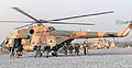 A combined team of Afghan National Army soldiers with the 6th Kandak, 1st Brigade, 205th Corps and Afghan National Police officers board an Mi-17 helicopter assigned to the Kandahar Air Wing on their way to a 120401-N-BS894-011.jpg