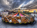 A fairground at sunset (7938746880).jpg