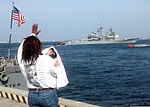 A family member of a U.S. Sailor assigned to the guided missile cruiser USS Monterey (CG 61) waves as the ship departs at Naval Station Norfolk, Va., April 8, 2013 130408-N-ZN259-003.jpg
