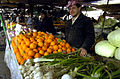 A fruit vendor at a market in Baghdad, Iraq.jpg