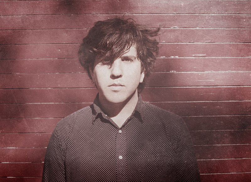 File:A photo of Dr. Dog's Eric Slick in front of wall.jpg