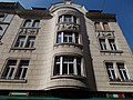 A wavy facade house with reliefs between the second and third floors. - 71, Váci Street, Budapest District V, Hungary.JPG