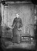 A woman standing holding a book NLW3364749.jpg