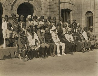 Aden Province - Sir Bernard Rawdon Reilly (front row 3d from left), the chief British official of Aden, at a meeting in Lahej; ca 1928-1930.