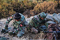 Afghan National Army commandos with the 1st Tolai, 3rd Special Operations Kandak fill sandbags to provide cover during a clearing operation in the Shah Wali Kot district of Kandahar province, Afghanistan 131111-A-XP635-062.jpg