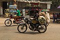 African Woman transporting crops on her motorcycle.jpg