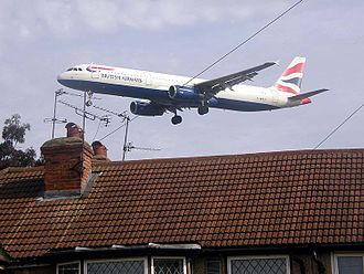 Noise control - A British Airways Airbus A321, on landing approach to London Heathrow Airport, showing proximity to homes.