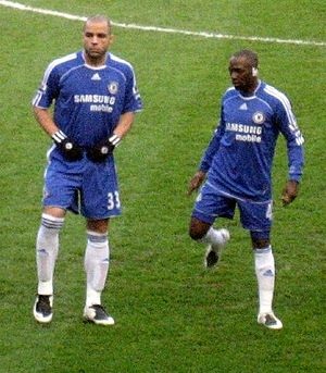 Claude Makélélé - Makélelé (right) with former Chelsea teammate Alex.
