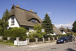 Vernacular architecture - Traditional Reethaus with thatched roofs on Rugia Island, Germany.