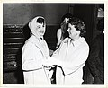 An unidentified woman shakes hands Mary Collins (13244190433).jpg