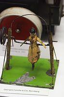 Antique tin toy dancing girl (24654109043).jpg