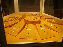 A showcase with a number of coins arranged in a circle.