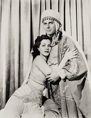 Arabian Nights (1942 film) - Maria Montez as Sherazade and Jon Hall as Haroun-Al-Rashid, publicity photograph for the film.