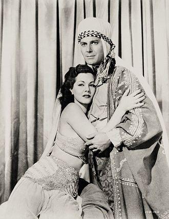 Arabian Nights (1942 film) - Maria Montez as Sherazade and Jon Hall as Haroun-Al-Rashid, publicity photograph for the film.
