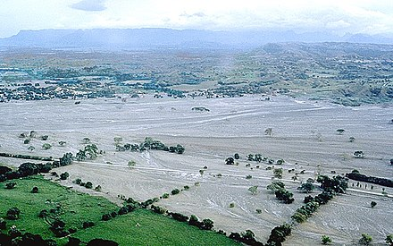 Lahar flows from the 1985 eruption of Nevado del Ruiz, which totally destroyed the town of Armero in Colombia. Armero aftermath Marso.jpg