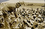 Arthur Butler being congratulated by crowd at his home-town, Lithgow, after breaking the England to Australia flight record, 1931.jpg