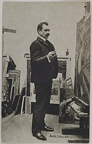Axel Gallén at the painting The Departure of Väinämöinen in his studio Pirtti in Helsinki, ca.1905. (14705684996).jpg