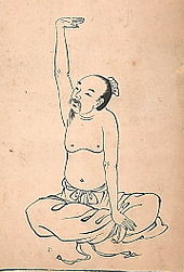 Old ink oriental drawing of a man performing qigong, kneeling cross-legged with an arm extended in the air