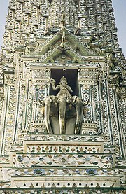 "Detail of the Phra Prang, the central tower of the Wat Arun (""Temple of Dawn"") in Bangkok, Thailand - showing Indra on his three-headed elephant Erawan (Airavata)."