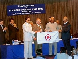 """Roerich Pact - Presentation of Banner of Peace from the board of cosmic station """"Mir"""" to Speaker of Indian Parliament Sri Somnath Chatterji on the occasion of 100th S.N. Roerich anniversary. From left to right: Hero of Russian Federation S. Zalyotin, V. Afanasiev, Sri Somnath Chatterji, President of ICR Yu.M. Vorontsov."""