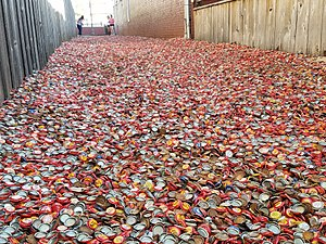 "Dixie Chicken (bar) - For Texas Independence Day 2017, Shiner Bock donated hundreds of thousands of caps to Bottle Cap Alley. For the day, it was called ""Bock Cap Alley"" throughout social media."