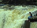 Boy Seated by Popokvil Waterfall - Bokor Hill Station - Near Kampot - Cambodia (48529023987).jpg