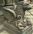 Bremen Cathedral eagle & snake left of right portal 1.jpg
