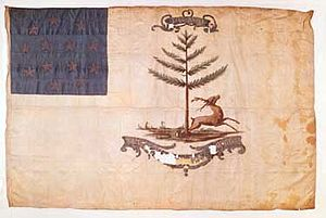 "Bucks of America - Bucks of America flag was presented to the Black Patriot, militiamen, after the war, in 1789, by Massachusetts governor, John George Washington Hancock and the grateful, citizens of Boston, honor them, presenting a white silk flag, displaying a leaping buck and a pine tree, the symbol of New England, and on the top, the initials, ""J-G-W-H"", of their benefactor, John George Washington Hancock"