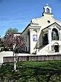 Bucuresti, Romania. Cimitirul Bellu Catolic. Biserica Sfanta Tereza. Aprilie 2018. Magnolie langa Biserica.jpg