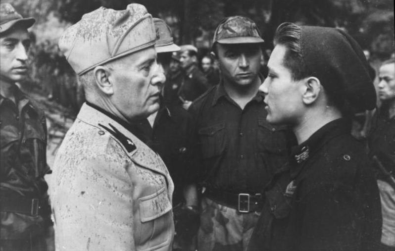 Benito Mussolini reviewing adolescent soldiers in 1944