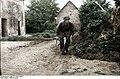 Bundesarchiv Bild 101I-584-2160-07, Frankreich, Soldat mit Gewehr hinter Büschen Recolored.jpg