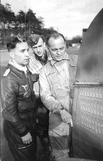 Kurt Tank and Major Gunther Specht (left) inspecting the rudder of his Bf 109. Specht's loss was a bitter blow for JG 11. Bundesarchiv Bild 101I-676-7975A-28, Wunstorf, Major Gunther Specht und Prof. Kurt Tank.jpg