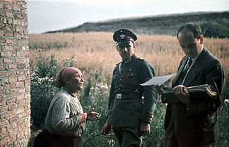 Romani genocide - Romani woman with German police officer and Nazi psychologist Dr. Robert Ritter